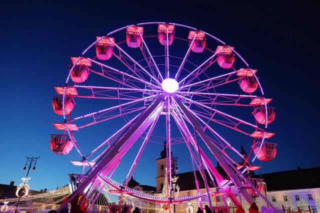 Ferris wheel at Christmas fair, red lights