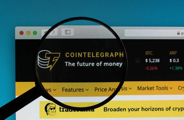 Cointelegraph logo under magnifying glass