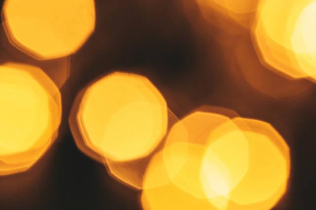 Yellow bokeh of blurred glowing garland