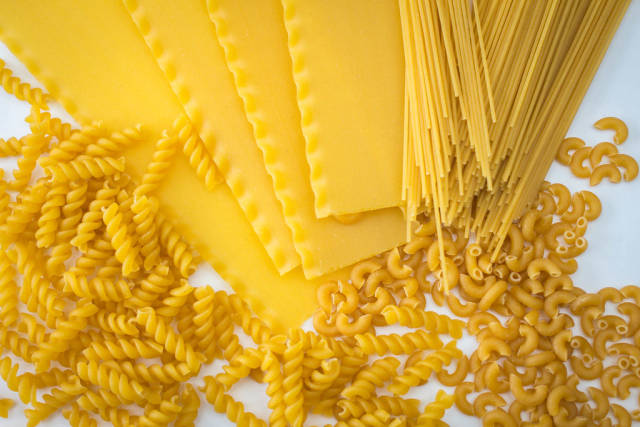 Assortiment of Uncooked Pasta on a White Background