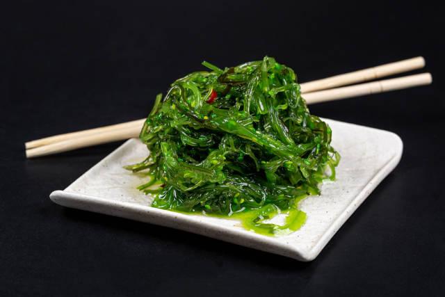 Japanese cuisine - chuka seaweed salad, served with nuts sauce and sesame