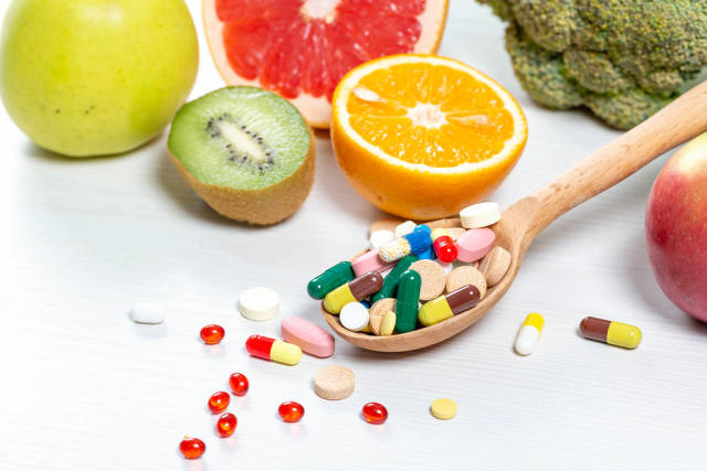 Colorful fruits and pills.The concept of vitamins in food and medicines
