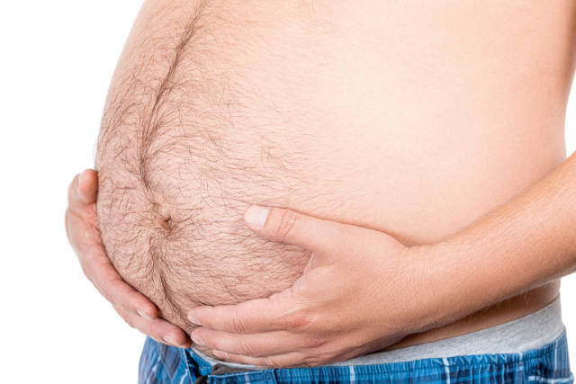 Man with beer belly on white background