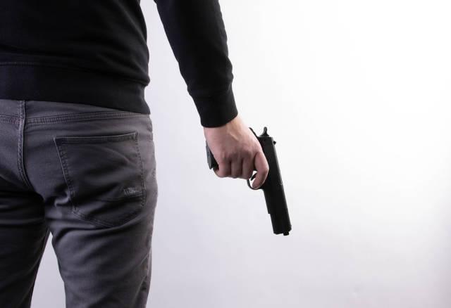 Man holding a gun in hand