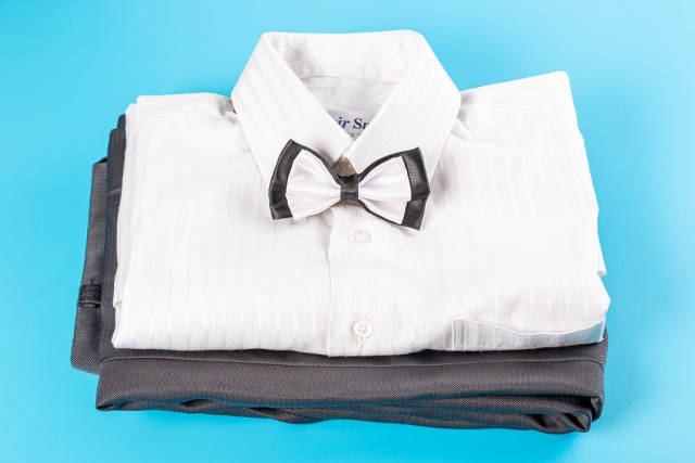 Mens childrens clothing on a blue background, classic style