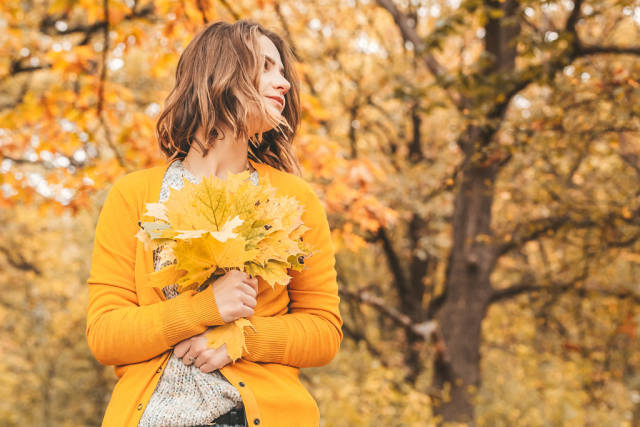 Beautiful young woman - colorful autumn portrait