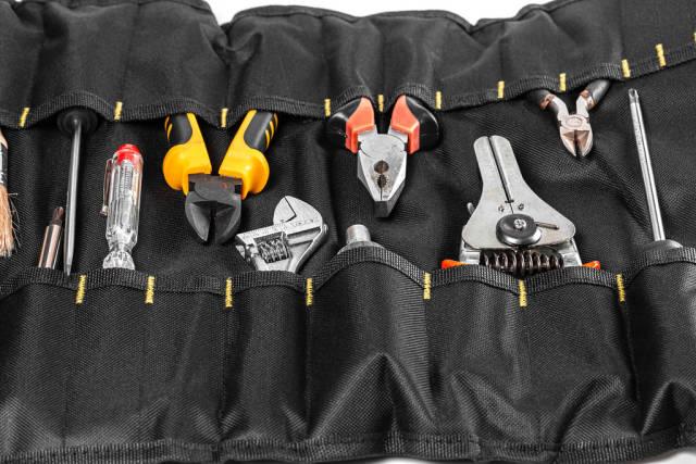 Background of various tools in black bag