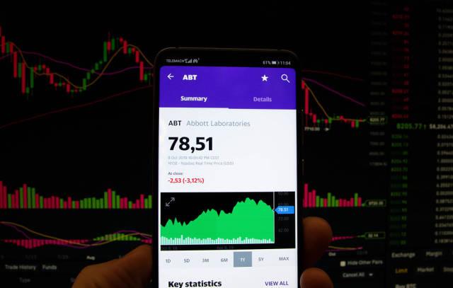 A smartphone displays the Abbott Laboratories market value