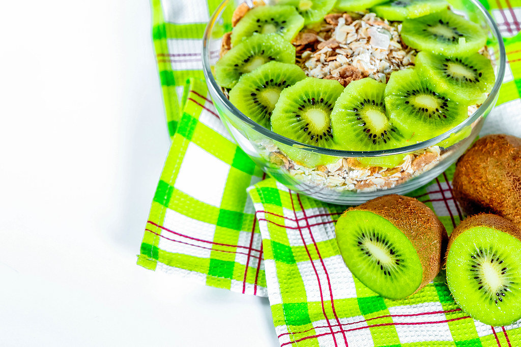 A good and healthy Breakfast - cereal and fresh fruit kiwi