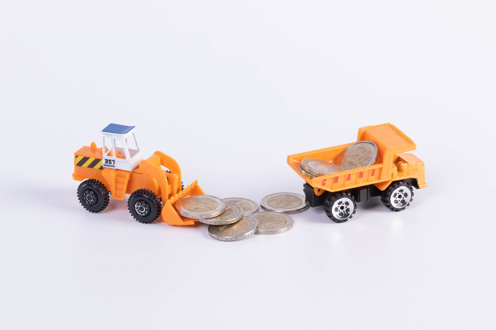 Excavator and truck with 2 Euro money coins