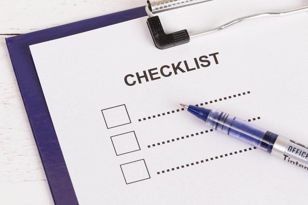 Empty checklist with pencil on clipboard