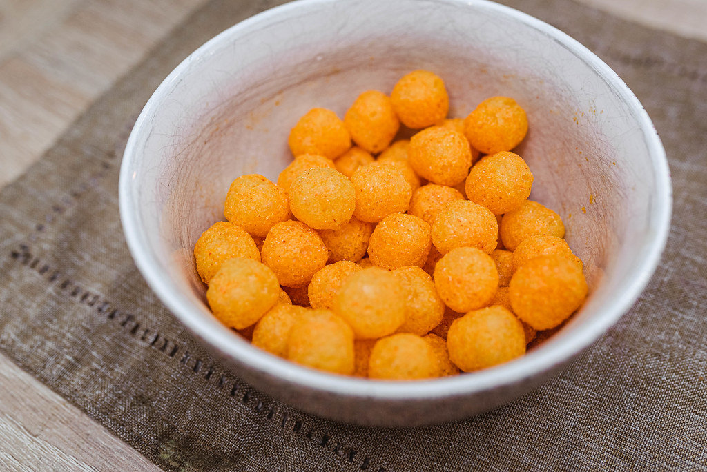 Background Of Extruded Puff Cheese Balls From Above