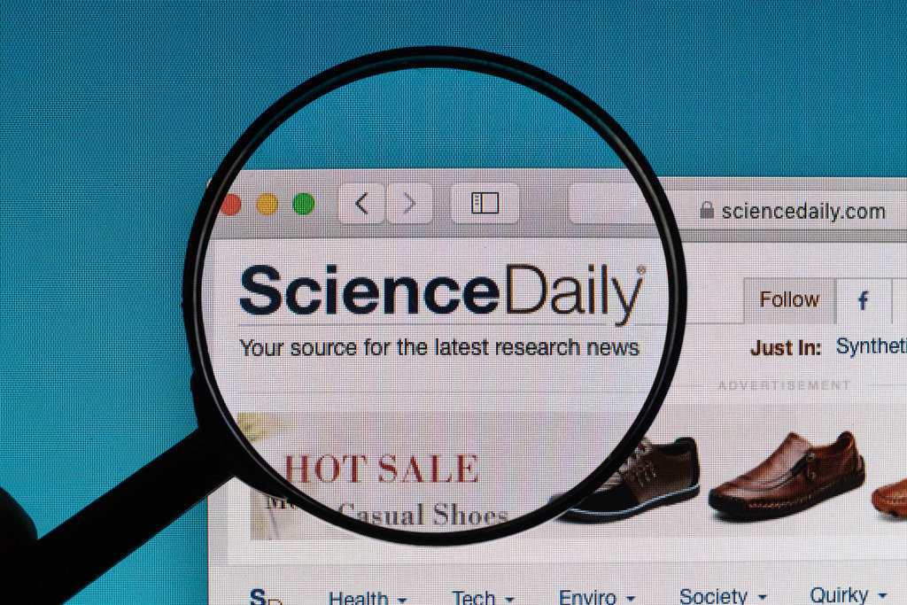 ScienceDaily logo under magnifying glass