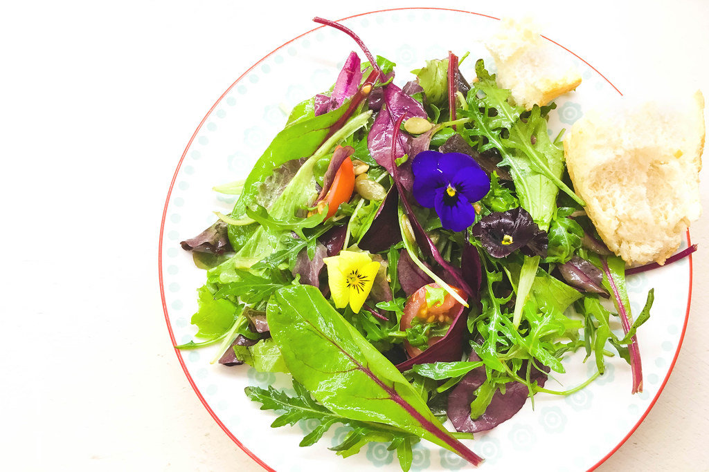 Fresh salad with edible flowers