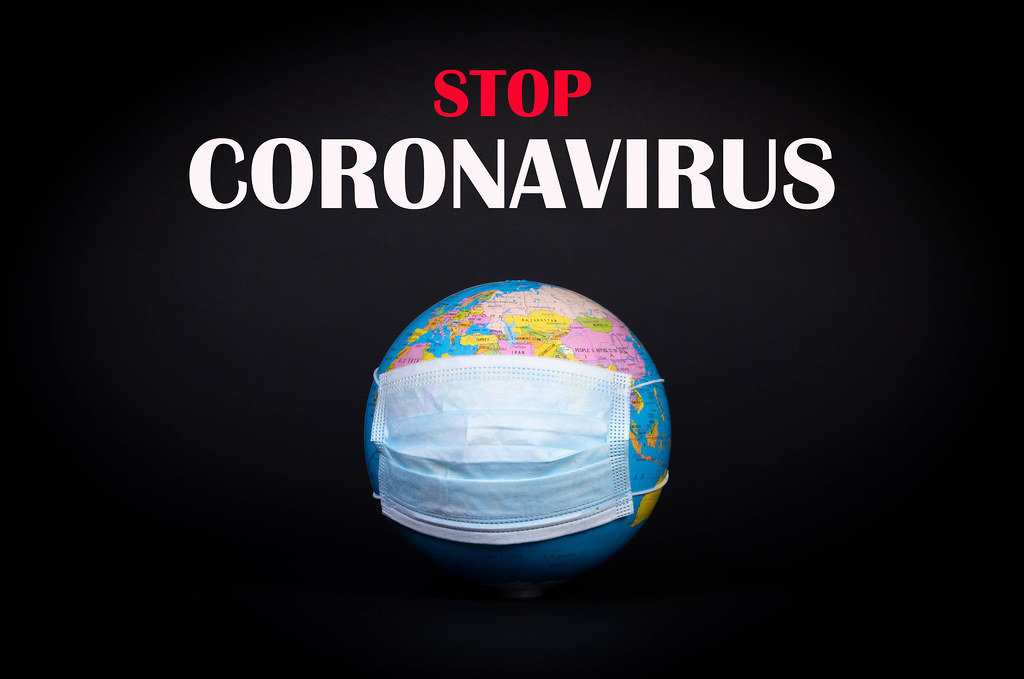 Globe with face mask and Stop Coronavirus text