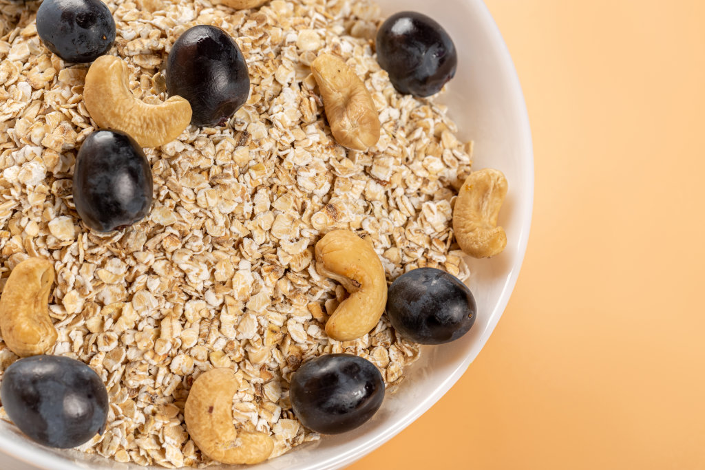 Close-up, oatmeal with grapes and cashews