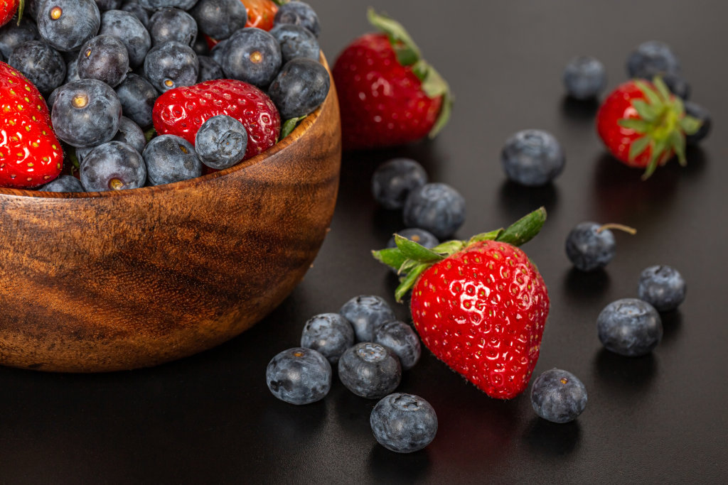 Strawberry and blueberries fresh berries - fruit background
