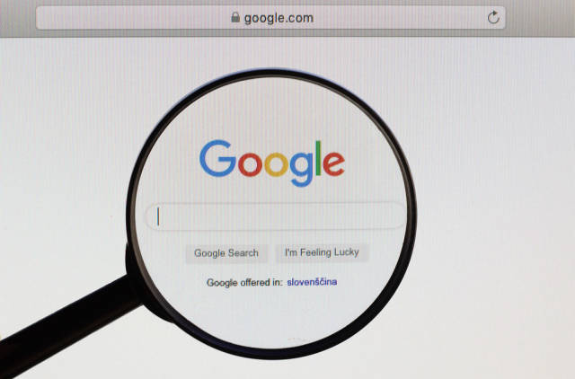 Google logo under magnifying glass