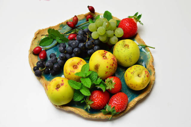 Quince fruit, strawberries, grapes and rosehips