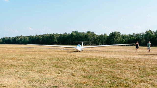 Student rolling her glider back to the start position at the airfield