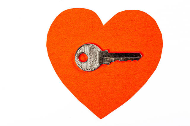 Red paper heart and key, concept of love and valentines day