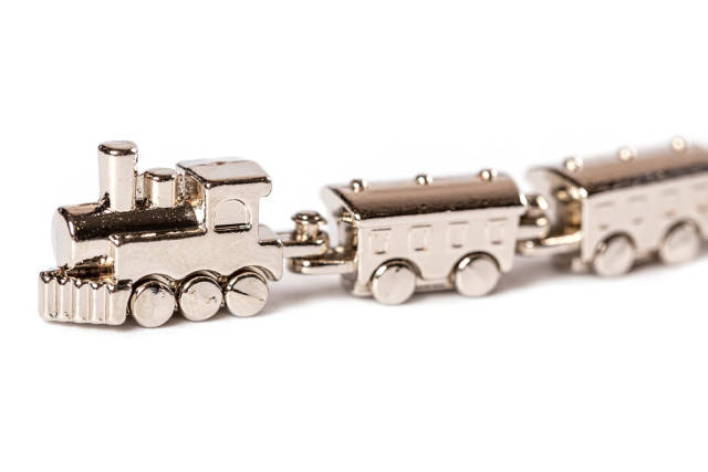 Miniature metal model of a steam locomotive with carriages, close-up