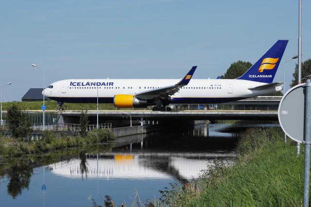 Icelandair plane taxiing on the bridge at Amsterdam Airport, bridge over water