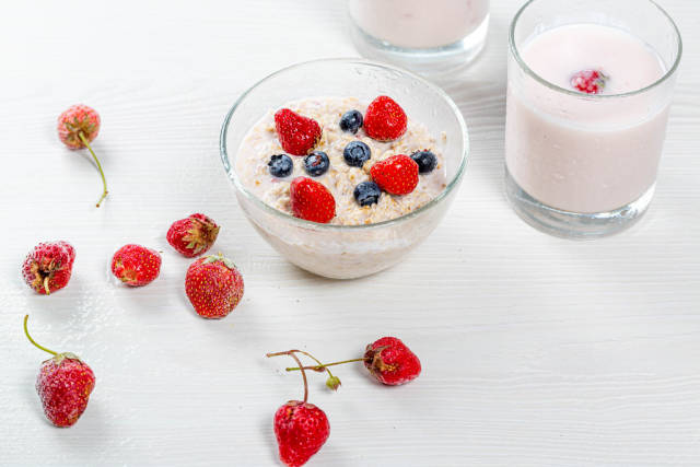 Healthy Breakfast concept. Oatmeal with berries and yogurt