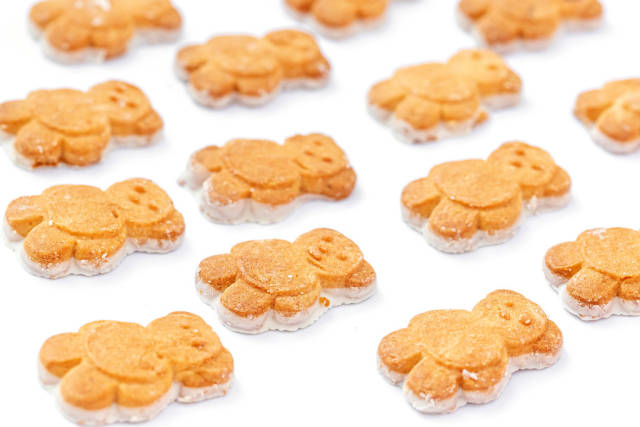 Baby cookies in the shape of bears on a white background