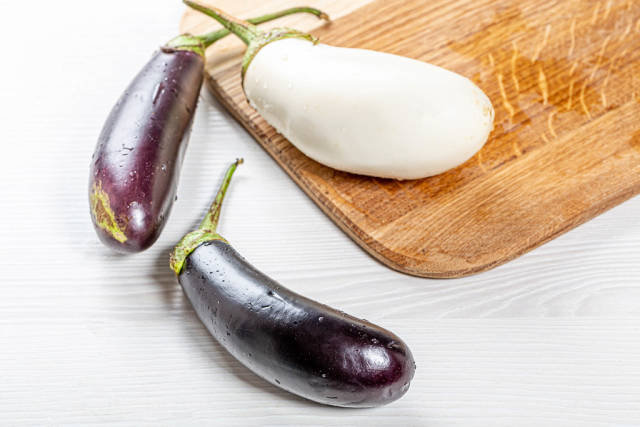 Fresh ripe purple and white eggplant