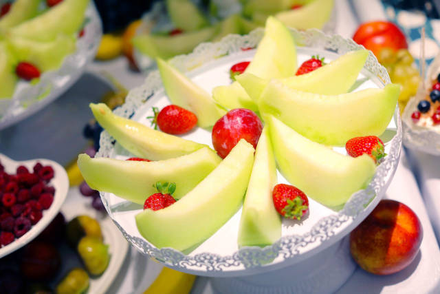 Fruit salad with melon and strawberries