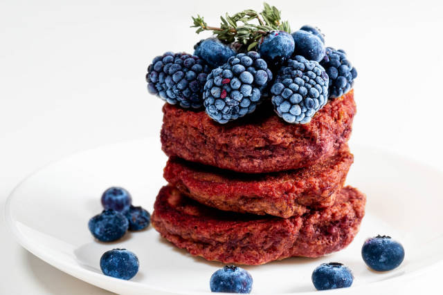 Close-up, beetroot pancakes with blueberries and mulberries