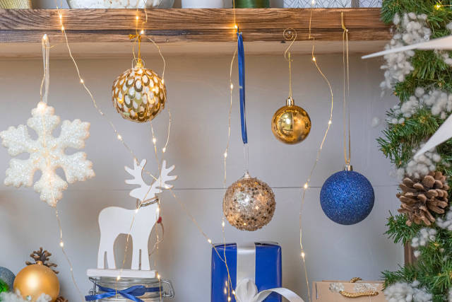 New Year decoration and gift on shelves with garlands