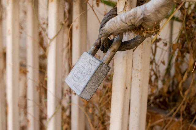 Lock on fence in sunlight