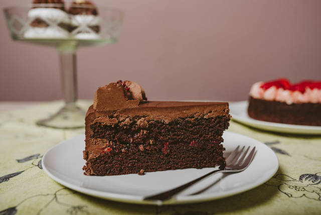 Plate with slice of tasty homemade chocolate cake