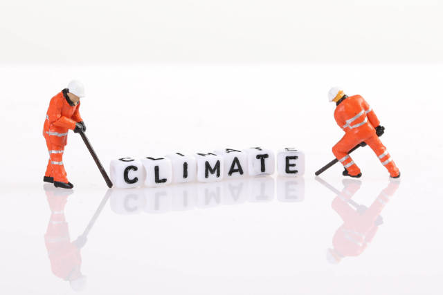 Workers figures with Climate text