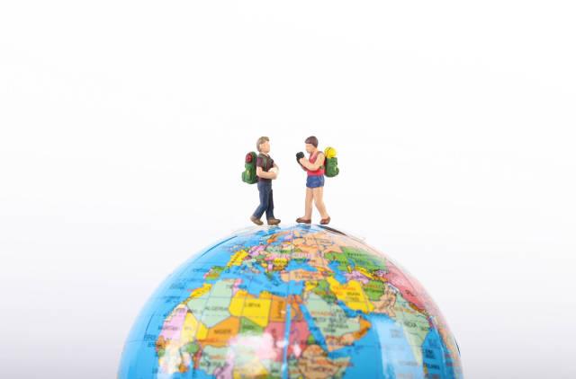 Miniature travelers on globe
