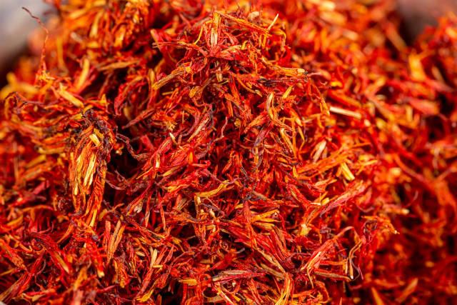 Dried red saffron spice background