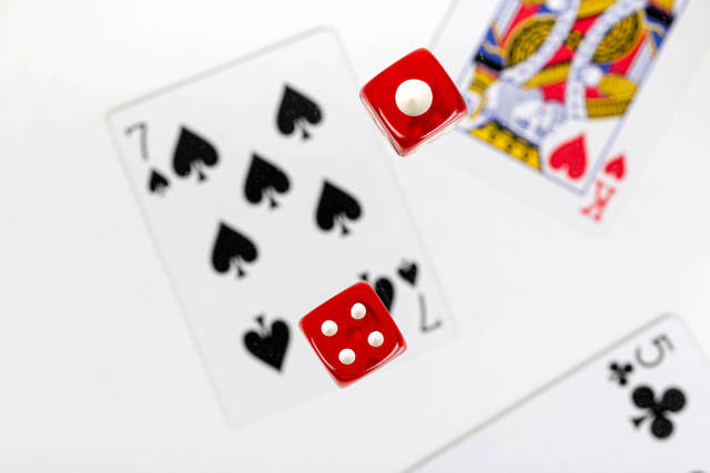 The concept of gambling and luck. Dice and cards
