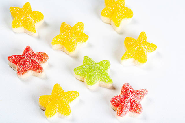 Jelly candies in the shape of stars on a white background
