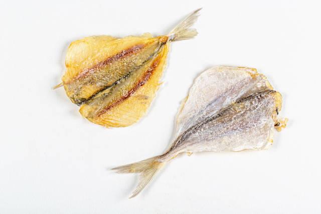 Dried silver horse mackerel on white