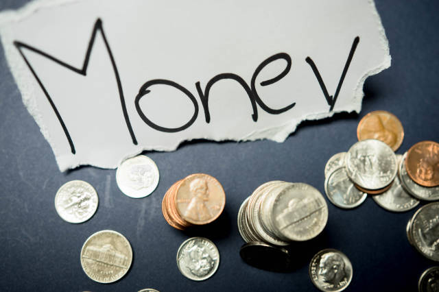 MONEY tag with coins around it
