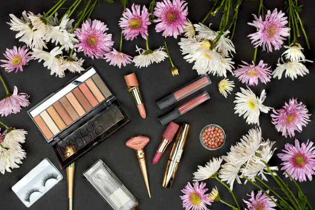 Spring flowers and beauty tools on dark background