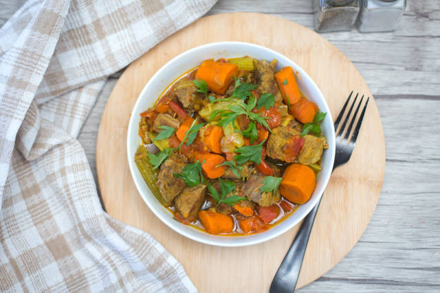 Beef Stew with Vegetables in a White Bowl Top View