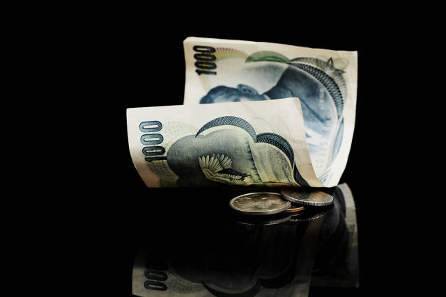 Yen, Nippon currency on black background