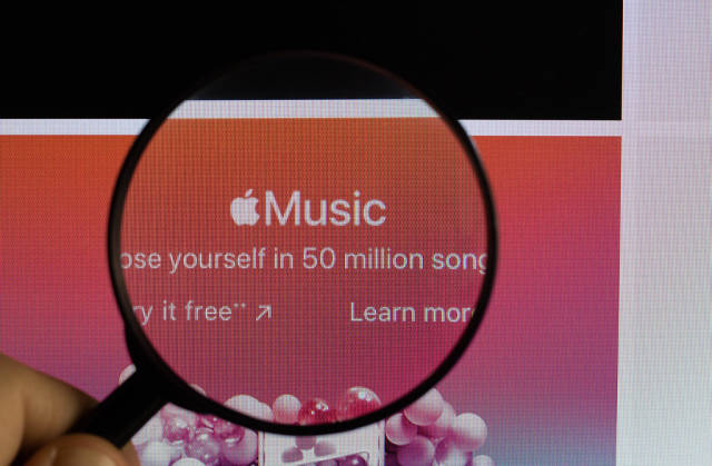 Apple Music under magnifying glass