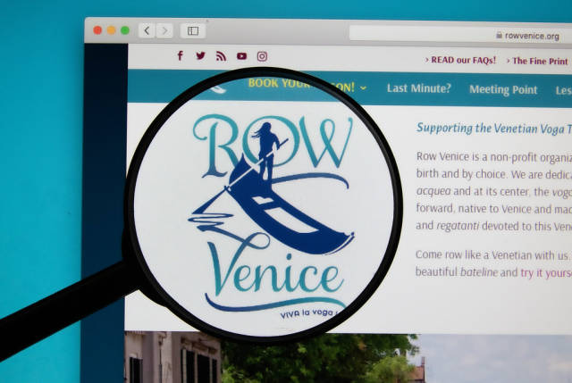Row Venice logo on a computer screen with a magnifying glass