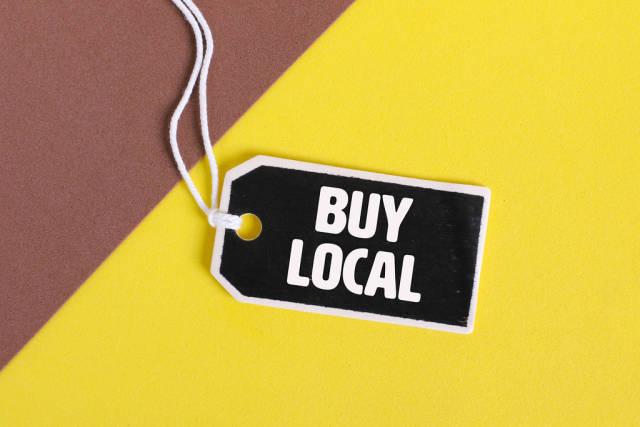 Buy Local handwritten gift box label on yellow background