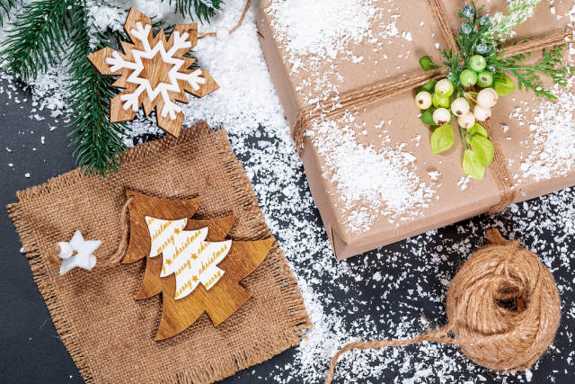 Gift in original box on snow background. The concept of preparing for the winter holidays