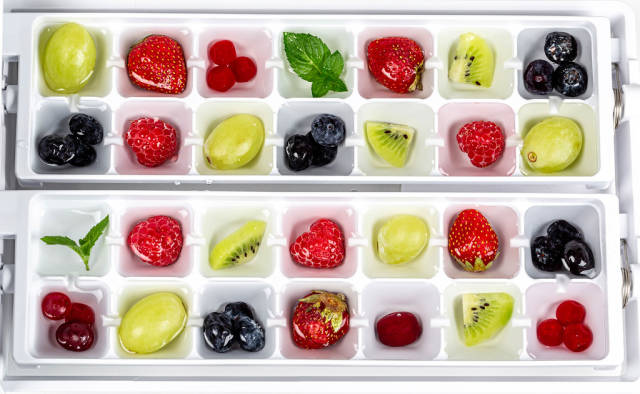 Colorful berries, fruits and mint are prepared for freezing fruit ice